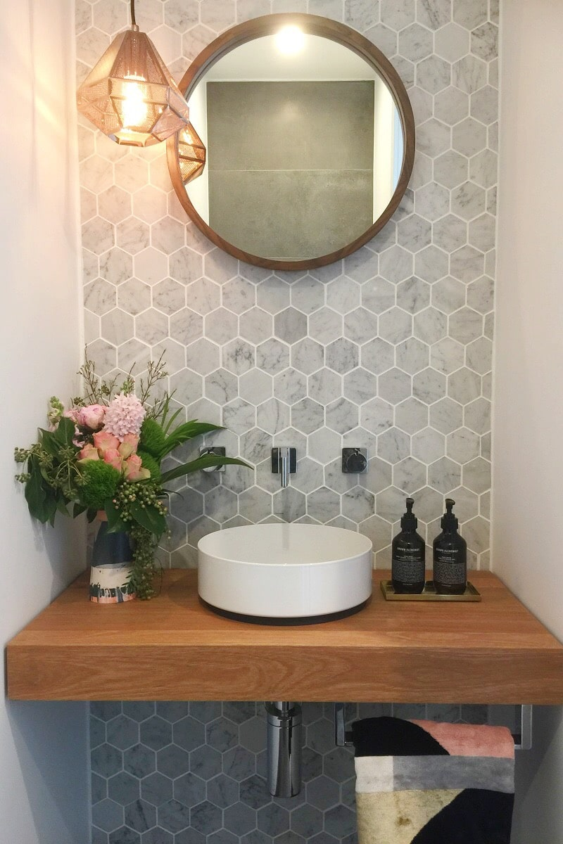 Powder room. Carrara marble paired with timber, steel and sleek fixtures.